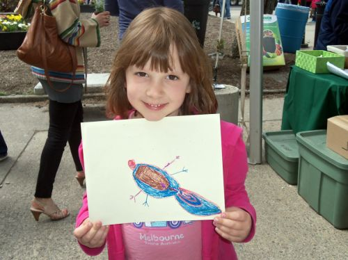 child-draws-tadpole-art