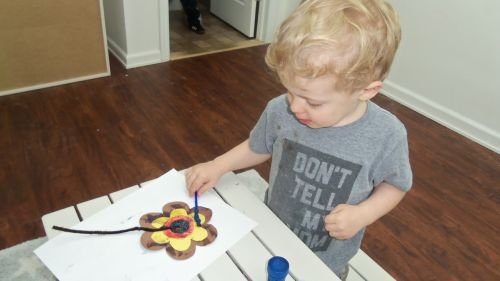 Painting cut paper flowers for Spring in Peaceful Frogs class in Hoboken with Susan Newman