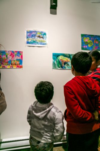 Children admiring the frog art at the Green Dream exhibition in Jersey City on Earth Day. Photo by Danny Chong.