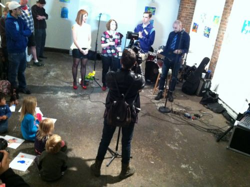 Jersey City 1 TV films, Frogs Are Green founder Susan Newman and Mayor Steven Fulop with Distillery Gallery curators