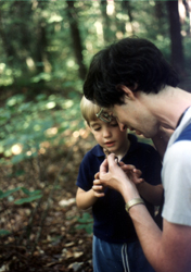 My husband John and son Jeremy looking at a toad