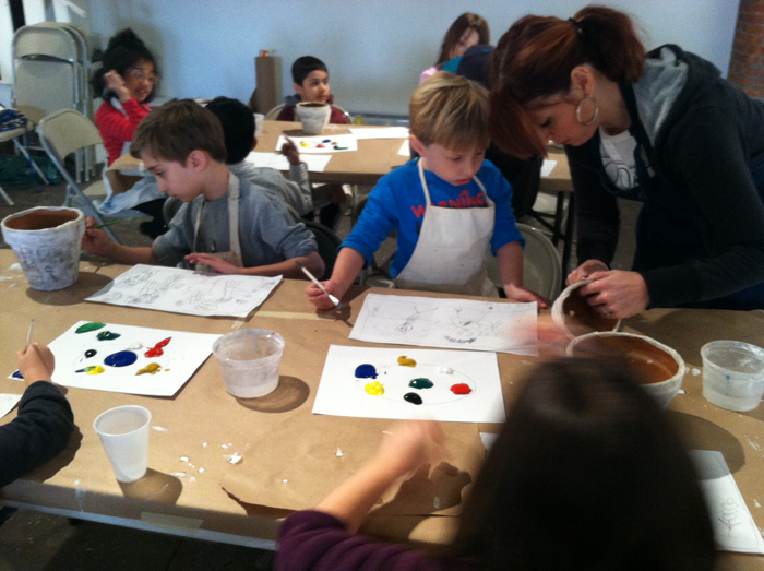teacher and students painting in art class