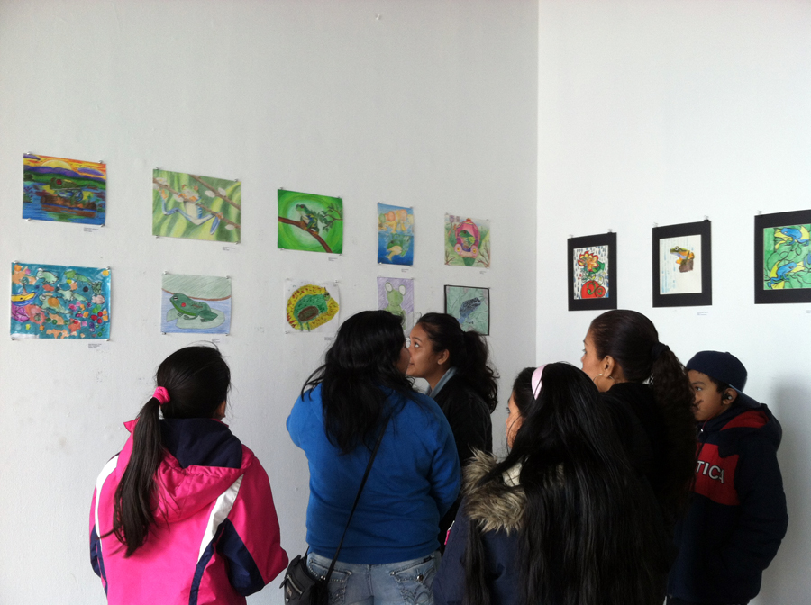 family admires environmental and frog art at 58 Gallery in Jersey City