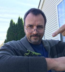 John Cichowski, teacher with praying mantis