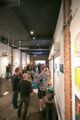 Crowd at The Distillery Gallery for the Green Dream - Save the Frogs Day event in Jersey City. Photo by Danny Chong.