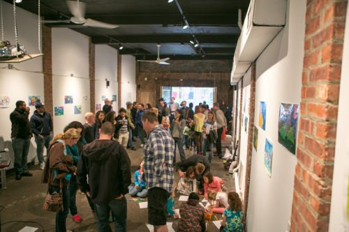 Crowded gathering at Green Dream's Save the Frogs Day event at The Distillery Gallery in Jersey City. Hosted by Frogs Are Green. Photo by Danny Chong.