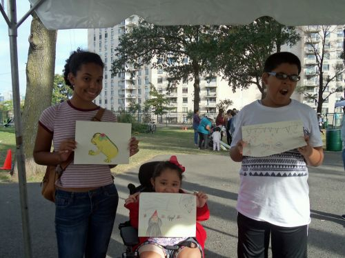 Kids of all ages drawing frogs in the park