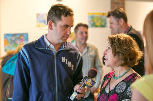 Mayor Steven Fulop and Frogs Are Green founder Susan Newman discuss frog decline and the Green Dream - Save The Frogs Day event at The Distillery Gallery in Jersey City. Photo by Danny Chong.