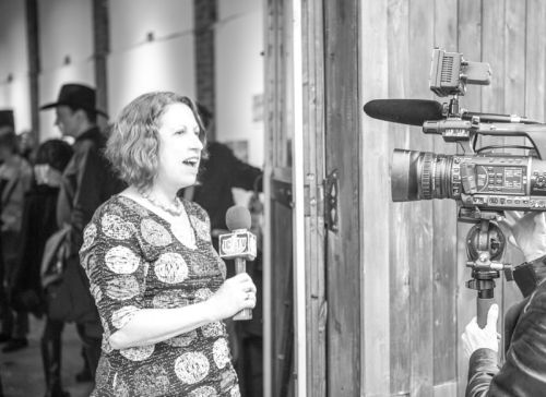 Susan Newman, founder of Frogs Are Green being interviewed by JC1TV at the Green Dream - Save The Frogs Day event, The Distillery Gallery in Jersey City. Photo by Danny Chong.