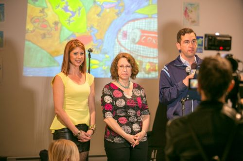 JC1TV reporter films Frogs Are Green's Green Dream - Save the Frogs Day event with Mayor Fulop at The Distillery Gallery. Photo by Danny Chong.
