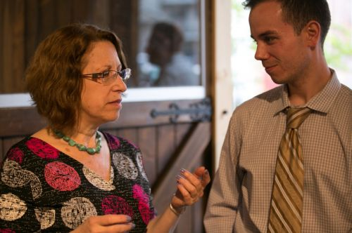 Susan Newman, founder of Frogs Are Green talking with Mayor Fulop's assistant at the Green Dream - Save The Frogs Day event, The Distillery Gallery in Jersey City. Photo by Danny Chong.