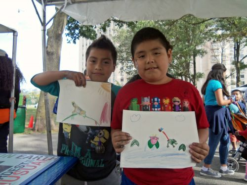 Boys creating frog art at Washington Park Live