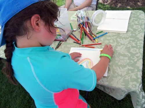 City of Water event draws parents and children and Frogs Are Green inspires drawing.