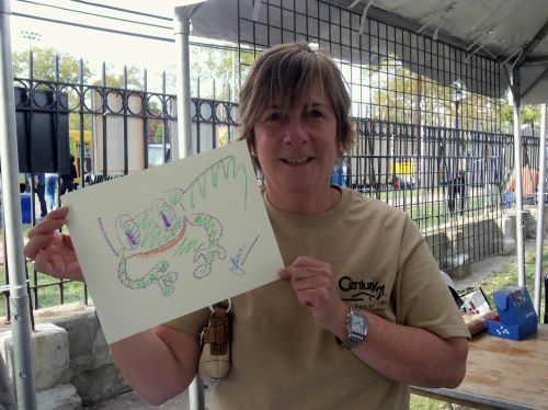 Laura Skolar displays her frog drawing at WPLIVE