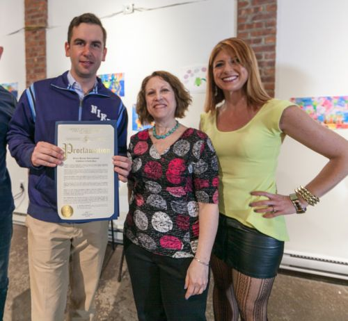 Mayor Steven Fulop, Susan Newman and Kristin DeAngelis with proclamation for Frogs Are Green's Green Dream International Children's Earth Day Exhibition at The Distillery Gallery. Photo by Danny Chong.