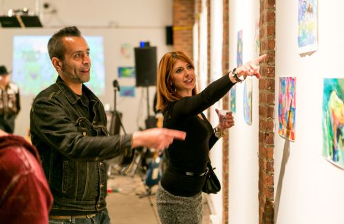 Kristin DeAngelis talks about frog art during the Green Dream opening at The Distillery Gallery in Jersey City. Photo by Danny Chong.