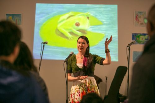 Michelle Luebke, environmentalist and instructor at CUNY, guest speaker, talking about frogs at the Green Dream - Save The Frogs Day event, The Distillery Gallery in Jersey City. Photo by Danny Chong.