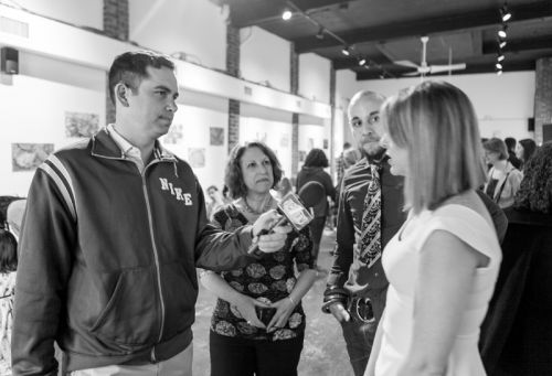 Mayor Steven Fulop discusses the Green Dream Exhibition event at The Distillery Gallery with Susan Newman, Kristin DeAngelis and Gabriel Pacheco.