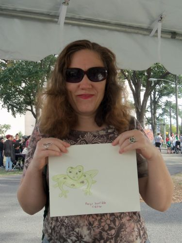 Amy Neufeld draws a frog at Washington Park Live
