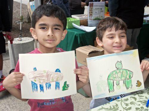 two-boys-display-frog-drawings