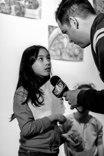 Mayor Fulop interviews one of the children at Frogs Are Green's Green Dream - Save The Frogs Day event at The Distillery Gallery. Photo by Danny Chong.