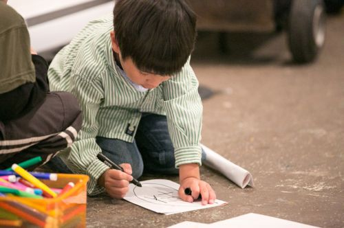 Child drawing during Green Dream's Save the Frogs Day event at The Distillery Gallery in Jersey City. Photo by Danny Chong.