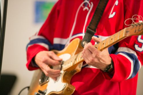 Dave Case playing guitar with The Gully Hubbards at Frogs Are Green's Green Dream - Save the Frogs Day event at The Distillery Gallery in Jersey City. Photo by Danny Chong.