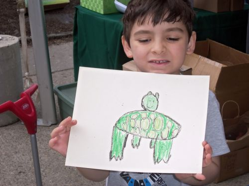 Young-boy-draws-a-frog