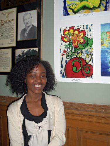 Jersey City student artist, Sarah Mongare with her winning artwork in City Hall