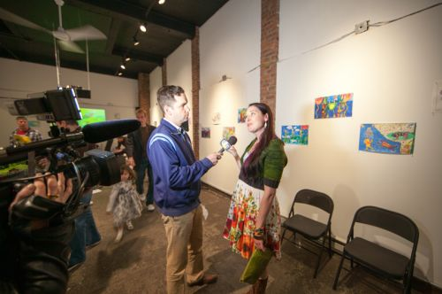 Mayor Steven Fulop interviews Michelle Luebke on frog decline and the environment for JC1TV at Frogs Are Green's Green Dream - Save the Frogs Day event at The Distillery Gallery. Photo by Danny Chong.