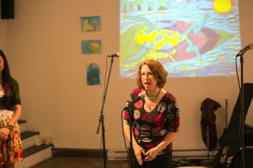 Susan Newman, founder of Frogs Are Green speaking to the crowd at the Green Dream - Save The Frogs Day event, The Distillery Gallery in Jersey City. Photo by Danny Chong.